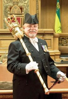 Saskatchewan sergeant at arms in full regalia with mace