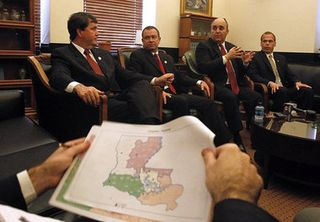 Senators Neil Riser and Joel T. Chaisson II, and Reps. Jim Tucker and Erich E. Ponti with Louisiana map
